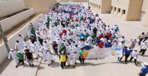 """"""" خطوتي صحتي """" مسيرة رياضية لطلاب الأولى المشتركة لنشر ثقافة المشي"""