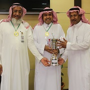 Dean Saad Alhusain with Basketball trophy